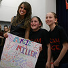 Beverly: Beverly native and American Idol Finalist, Angie Miller, poses for a photo with Elizabeth Athanas, 11, and Sophia Lumino, 12, as they present her with a poster at the Centerville Elementary School on Saturday afternoon. David Le/Salem News