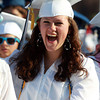 Peabody: Peabody High School graduate Mary Votto laughs during senior class essayist Benjamin Small's speech on Friday evening. David Le/Salem News
