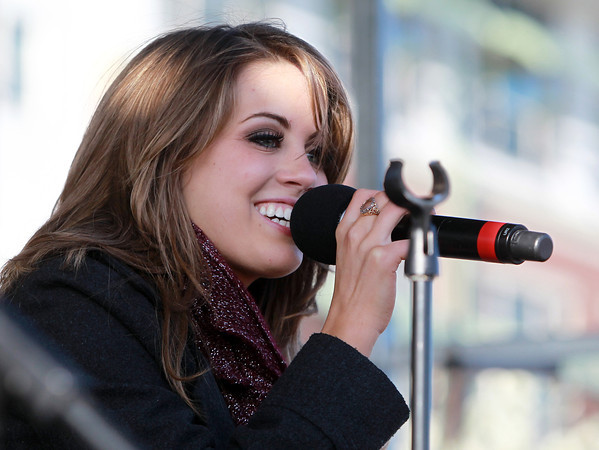 "Beverly: Beverly native and one of three finalists on this season of American Idol, Angie Miller sings ""Halo"" at a concert held outside Beverly High School on Saturday afternoon. A 2012 graduate of BHS, Miller returned to her hometown for the show's hometown visits, and was greeted by thousands of fans, lining Cabot St. in Beverly, and spilling onto the fields at the high school for a concert. David Le/Salem News"