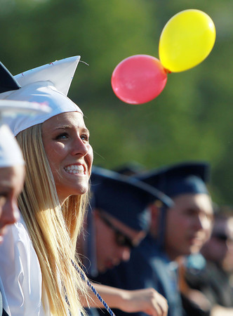 Peabody: Peabody graduate Bianca Muscato smiles as she watches a few balloons float past during Graduation on Friday evening. David Le/Salem News