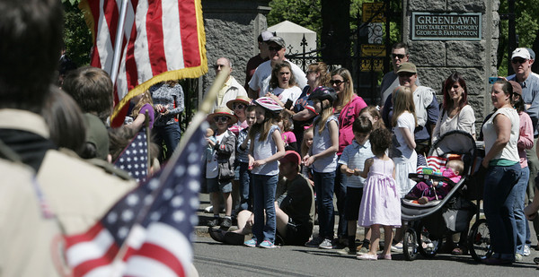 Salem:<br /> The parade marches past bystanders lining the street in front of the Greenlawn Cemetery during Salem's Memorial Day parade. <br /> Photo by Ken Yuszkus/Salem News, Monday May 27, 2013.