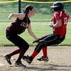 Marblehead:<br /> Newburyport's Kendra Dow misses the throw as Marblehead's Sarah Borstein slips past to second on a steal during the Newburyport at Marblehead Division 2 North tournament softball.<br /> Photo by Ken Yuszkus, Salem News, Thursday May 30, 2013.