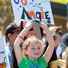 "Beverly: Eight-year-old Kayla Bello holds up a ""Go Angie"" sign outside Centerville Elementary School on Saturday afternoon as she waits for 2012 Beverly High School graduate Angie Miller to arrive. David Le/Salem News"