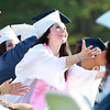 Peabody: Peabody High School graduate Josephine Gravallese reaches out to bat a beach ball high into the air during Graduation on Friday evening. David Le/Salem News