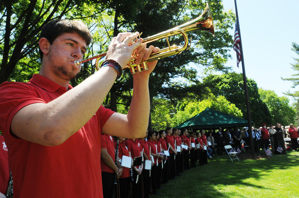 Salem:<br /> Salem High band member Chase Duffin plays taps on his trumpet and Rachel Coughlin, not pictured, plays the echoing second taps during Salem's Memorial Day ceremony at Greenlawn Cemetery. <br /> Photo by Ken Yuszkus/Salem News, Monday May 27, 2013.