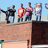 Beverly: People gathered on the rooftop of a building along Cabot St. to cheer on Beverly native and American Idol Finalist Angie Miller as she paraded from City Hall to Beverly High School. David Le/Salem News