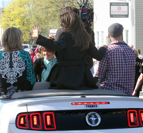 Lyza Parsons/Staff photo<br />  Angie Miller waves to the crowd during the parade for the American Idol contestant with her mother and brother at her side.