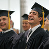 Danvers:<br /> Taylor Balletto of Groveland, left, and Mark Azarian of Salem, NH, react to the speech of Senior class speaker Nathaniel Torto of Marblehead during the St. John's Prep graduation ceremony at Ryken Field.<br /> Photo by Ken Yuszkus/Salem News,  Sunday May 19, 2013.