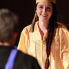 Peabody: Bishop Fenwick graduate Jennifer Langis smiles as she walks across the stage at Bishop Fenwick High School to receive her diploma during Commencement on Friday evening. David Le/Salem News