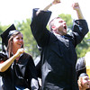 Wenham: Gordon College graduates Alexandra Barker and Kenny Stirling stand up and cheer loudly as their classmates cross the stage and receive their diplomas during Commencement on Saturday morning. David Le/Salem News
