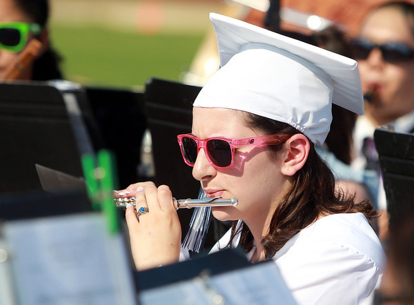 Peabody: Peabody High School graduate Caroline Hassan plays flute with the PVMHS Band prior to the start of Graduation on Friday evening. David Le/Salem News