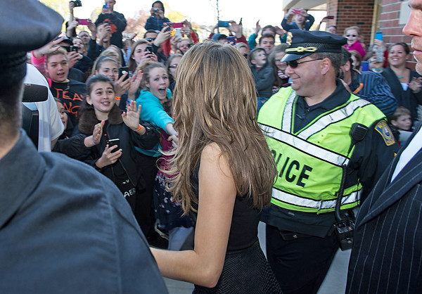 Desi Smith/Gloucester Daily Times.  American Idol finalist Angie Miller makes her way to a waiting limo past screaming fans at Beverly High School Saturday afternoon.  May 2,2013