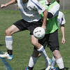 Danvers:<br /> Danvers' Kyle Cahill and Beverly's Jacob Brodbine eye the loose ball during the Beverly Banshees vs the Danvers Panthers U16 soccer game at the Danvers Invitational Tournament held at Danvers High School.<br /> Photo by Ken Yuszkus/Salem News, Monday May 27, 2013.