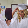 Middleton:<br /> North Shore Tech grads Leah Bolduc of Peabody holds the mirror for April Hannable of Salem while she pins her mortar board on her head as they are get ready for the graduation ceremony.<br /> Photo by Ken Yuszkus, Salem News, Thursday May 30, 2013.