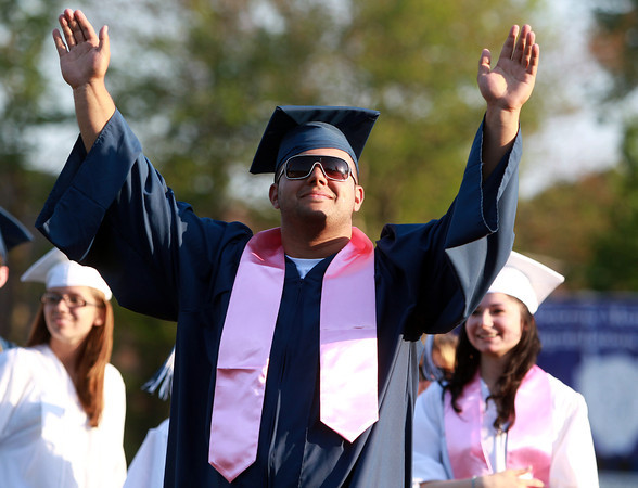 Peabody: Peabody High School graduate Athan Goulas raises both his arms in the air in triumph as his name is called during Graduation on Friday evening. David Le/Salem News