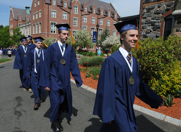 Danvers:<br /> From right, valedictorian David O'Neil Danis of West Newbury is the first graduate in line, next is salutatorian Matthew Brady of Marblehead, and Joseph Flynn of Melrose, and Nathaniel Torto of Marblehead as they march through the St. John's Prep campus on the way to the graduation ceremony at Ryken Field.<br /> Photo by Ken Yuszkus/Salem News,  Sunday May 19, 2013.