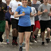 "Salem:<br /> Salem Charter School teacher Allison Rickenbach was 4/10th of a mile away from finishing the Boston Marathon last month before the race was halted by the explosions. Friday afternoon, she ""finished"" the marathon by running her final distance around the Salem Common, along with students from the Charter school's track team.<br /> Photo by Ken Yuszkus/Salem News, Friday June 10, 2013."
