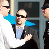 Salem: Brendan Lynch, center, step-brother of Salem State graduate and MIT police officer Sean Collier, talks with a few of Collier's friends from Salem State following a ceremony outside the Bertolon School of Business on Monday afternoon. David Le/Salem News