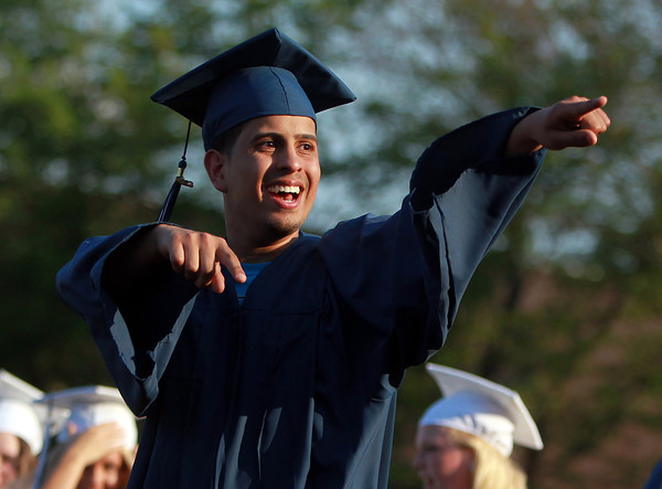 Peabody: Peabody High School graduate Guilherme Franco points to his family and friends as he walks across the field at PVMHS to receive his diploma on Friday evening. David Le/Salem News