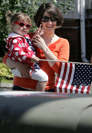 Salem:<br /> Claire Albuquerque, 2, waves to the marchers with the help of her mother Marcy, of Beverly, on North Street during Salem's Memorial Day parade. <br /> Photo by Ken Yuszkus/Salem News, Monday May 27, 2013.