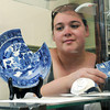 Danvers:<br /> Resident caretaker Candice Clemenzi looks toward the 1800's blue willoware plate and bowl which is part of the grand opening of the Rebecca Nurse Homestead archaeology exhibit.<br /> Photo by Ken Yuszkus, Salem News, Thursday May 30, 2013.