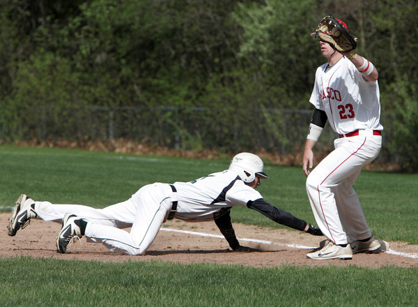 Topsfield:<br /> Pentucket's Pat Beaton gets back safely to first base on a pick-off try as Masconomet's first baseman Joe Klingensmith gets the throw during the Pentucket at Masconomet baseball game.<br /> Photo by Ken Yuszkus/Salem News, Tuesday June 14, 2013.