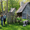 Salem:<br /> Natalia, 10, Cheri , and Alexei Grishin walk amongst the buildings at Salem Pioneer Village. Salem Pioneer Village, a living history museum set in 1630, which has been maintained and run by Gordon College for 4 years. The college has just announced they will terminate their lease with the city to run Salem Pioneer Village. The site is owned by the city and was built in 1930.<br /> Photo by Ken Yuszkus/Salem News, Friday June 10, 2013.
