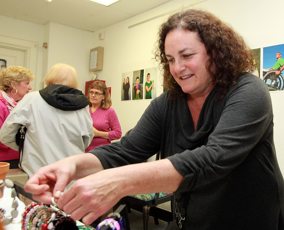 Peabody: Julie Cummings looks through some jewelry on display at the ArcWorks Community Art Center's Spring Soiree on Thursday evening. David Le/Salem News