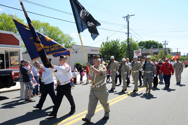 Salem:<br /> Carrying flags are, from left, Paul Berrett, Tom Higgin, and Charles Phipps as they march on North Street in Salem's Memorial Day parade. <br /> Photo by Ken Yuszkus/Salem News, Monday May 27, 2013.