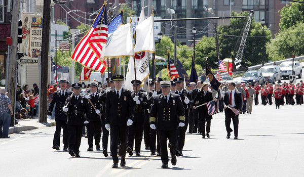 Salem:<br /> The police and fire personnel lead the Memorial Day parade on North Street in Salem.<br /> Photo by Ken Yuszkus/Salem News, Monday May 27, 2013.