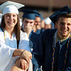 Peabody: Peabody High School graduates Olivia Brothers and Chris Therrien smile as they look out into the large crowd gathered in the bleachers for Graduation on Friday evening.  David Le/Salem News