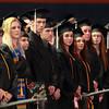 Salem: Salem State University graduates stand and listen to classmate Jenney Richards sing the National Anthem on Saturday afternoon. David Le/Salem News
