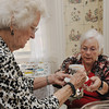 Salem:<br /> Mary Ann Buczko, left, is served a cup of coffee by Barbara Rafferty at the annual Florence Cobb Coffee hosted by the Woman's Friend Society which was held at the Emmerton House Wednesday morning. Proceeds support Emmerton House, Brookhouse Home for Women and Plummer Home for Boys.<br /> Photo by Ken Yuszkus/Salem News, Wednesday June 8, 2013.