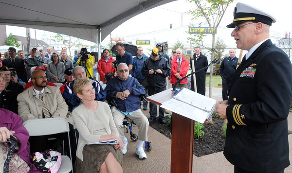 Peabody:<br /> Lt. Cmdr. Bob Dunne speaks during the ceremony for the opening of the new East End Veteran's Memorial Park.<br /> Photo by Ken Yuszkus/Salem News, Friday May 24, 2013.