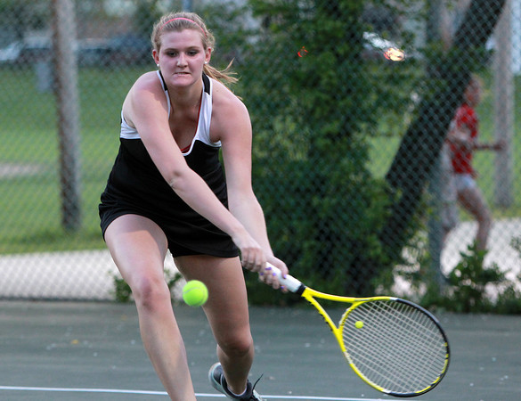 Marblehead: Marblehead third singles player Meghan Gabel reaches forward to return a volley against Manchester-Essex on Thursday evening. David Le/Salem News