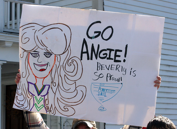 Lyza Parsons/Staff photo<br /> A fan holds a sign for Angie Miller along the parade route. The American Idol finalist came home to perform for the hometown crowd.
