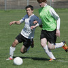 Danvers:<br /> Danvers' Alessio Kanani and Beverly's Sean Leahy battle for the ball during the Beverly Banshees vs the Danvers Panthers U16 soccer game at the Danvers Invitational Tournament held at Danvers High School.<br /> Photo by Ken Yuszkus/Salem News, Monday May 27, 2013.