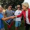 U.S. Senate candidate Elizabeth Warren, right, shakes hands with Corey Malone, Nicholas Nasser, and Dan Milaschewski, all 17 and from Beverly, upon arrival at Veterans Park in Beverly on Thursday evening. David Le/Staff Photo