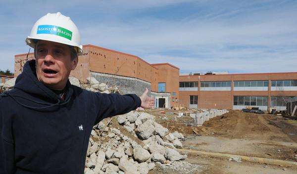 April 6, 2011: DPW Director David Lane speaks about the construction at Danvers High School. Photo by Ken Yuszkus/Salem News
