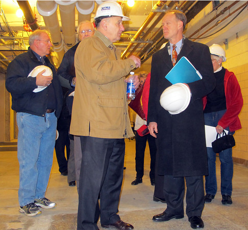 Jan. 13, 2012: Architect Kenneth DiNisco, president and principal of DiNisco Design Partnership of Boston, and Town Manager Wayne Marquis discuss the ongoing Danvers High renovation during a tour on Friday with members of the town's Design/Construction Advisory Committee and town officials.<br /> Ethan Forman/staff photographer