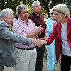 U.S. Senate candidate Elizabeth Warren shakes hands with Beverly Mayor Bill Scanlon following a quick speech at Veterans Park in downtown Beverly on Thursday evening. David Le/Staff Photo