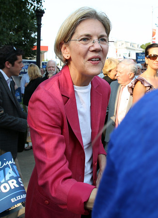 U.S. Senate candidate Elizabeth Warren shakes hands with her supporters upon arrival at Veterans Park in Beverly on Thursday evening. David Le/Staff Photo