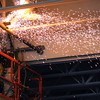 April 6, 2011: Sparks fly as a worker with a torch cuts metal fasteners to dismantle metal pipes used to hold basketball backboards in the gymnasium. It is part of the construction work being done at Danvers High School.<br /> Photo by Ken Yuszkus/Salem News