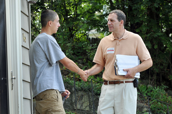 Beverly: State Representative candidate Jerry Parisella, right, introduces himself to Mason Brown of Beverly, who is enlisted with the US Army Reserves.   photo by Mark Teiwes / Salem News
