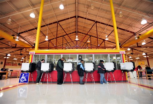 District 3 voters cast their ballots at Clarke Central High School during mid-term elections on Tuesday, Nov. 2, 2010 in Athens, Ga.  (AP Photo/ Athens Banner-Herald, Richard Hamm)  MANDATORY CREDIT MAGS OUT NO SALES TV OUT