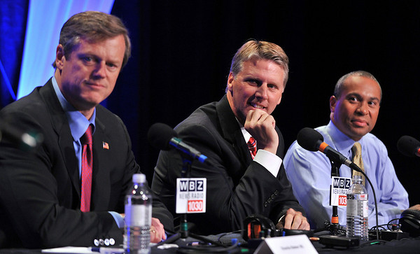 Gubernatorial candidates, from left, Republican Charles Baker, Independent Timothy Cahill, and  Democratic Gov. Deval Patrick, participate in a debate moderated by WBZ-AM host Dan Rae in Braintree Sept. 14, 2010. (AP Photo/Josh Reynolds)