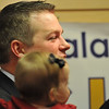 Beverly: Republican candidate Brett Schetzsle addresses his supporters holding his daughter Elliot after losing the Beverly state representative election.  photo by Mark Teiwes / Salem News