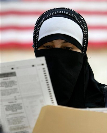 Tahani Ahmed checks her ballot after voting at Lowrey School in Dearborn Mich., Tuesday, Nov. 2, 2010. (AP Photo/Paul Sancya)