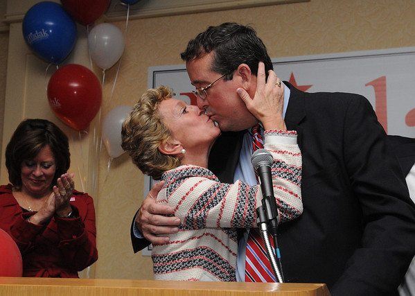 Peabody:<br /> Angela Hudak gives her husband, Bill Hudak, a kiss at the end of his concession speech. Bill Hudak lost the congressman's race for the 6th district. They are at the Peabody Marriott on Tuesday evening. His oldest sister, Angela, is on the left.<br /> Photo by Ken Yuszkus/Salem News, Tuesday, November 2, 2010.