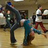 Beverly: Jasmine Mitchell does a cartwheel at Jerry Parisella's election night party.  photo by Mark Teiwes / Salem News